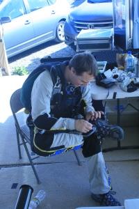 Jumper 2 setting up 2.4GHz trasmitter on his leg